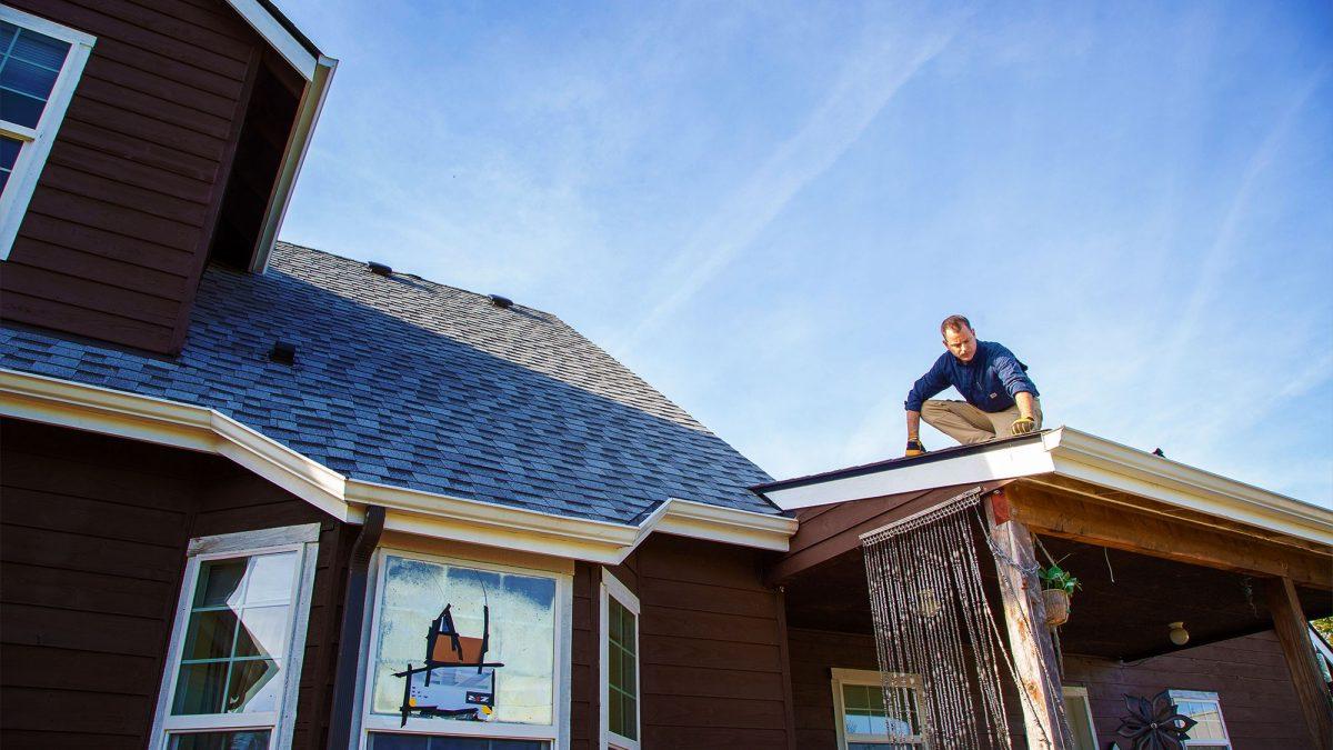 Trevor Rice on roof for SGA Inspections